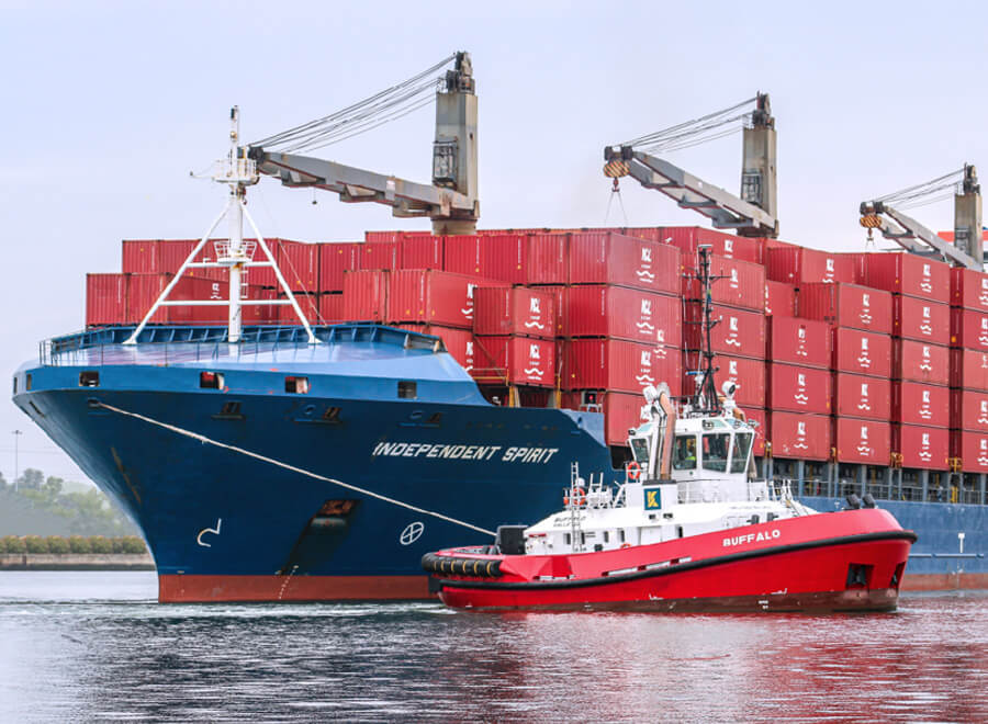 Johnson Stevens Ltd. Independent Container Line ship being towed into harbour